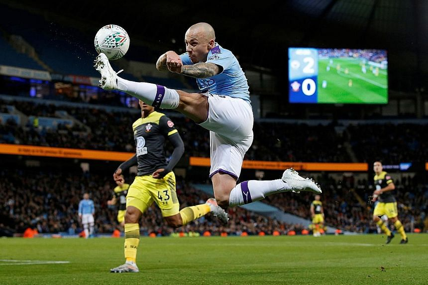 City's Spanish defender Angelino stretching for the ball against Southampton in their League Cup last-16 tie at the Etihad Stadium on Tuesday. While the Saints lost 3-1, it was a vast improvement from their 9-0 drubbing by Leicester in the league las