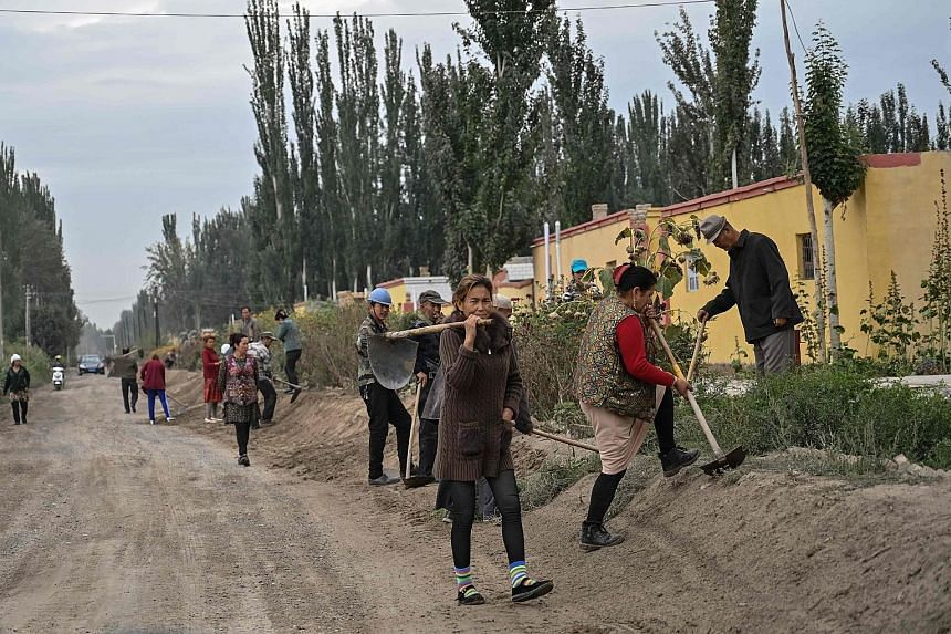 """A village (above) in Xinjiang where Uighurs live. China has been condemned for setting up complexes in Xinjiang that it describes as """"vocational training centres""""."""