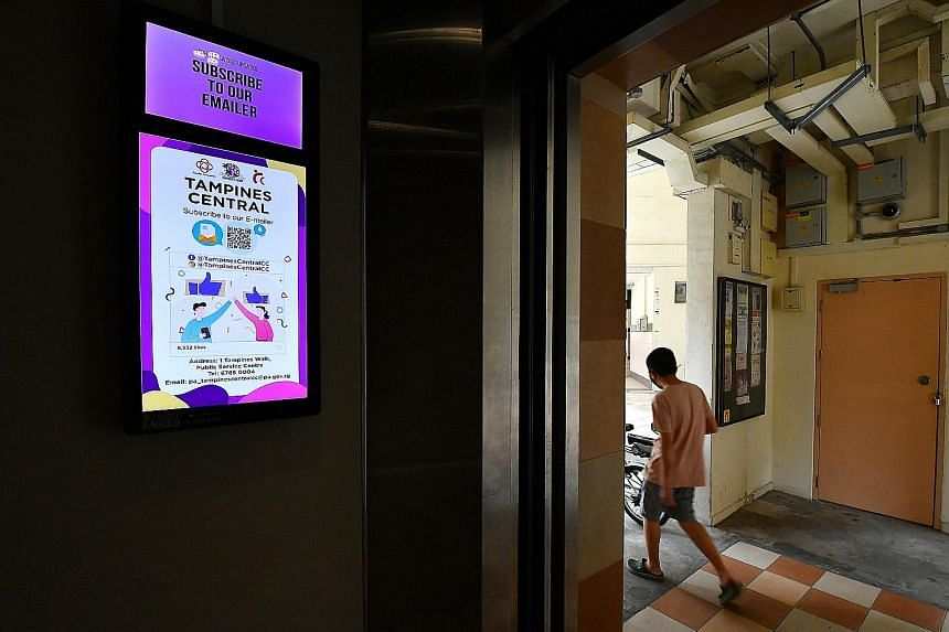 A digital display panel inside a lift at Block 842 Tampines Street 82. Several town councils have already installed about 8,700 such panels in the common areas of HDB blocks. ST PHOTO: LIM YAOHUI