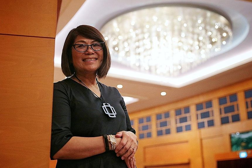 Lee Hui Feng, principal of Qihua Primary, says the emphasis has switched from results to greater participation. She is one of 148 principals and teachers lauded for their service to the two school sports councils.