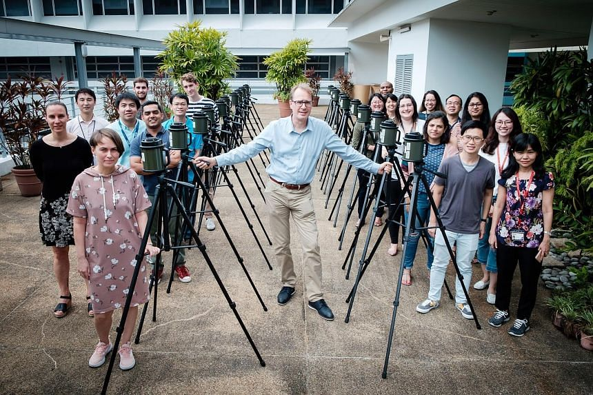 Singapore Centre for Environmental Life Sciences Engineering research director Stephan Schuster with air sample collectors and his team of researchers who worked on the study of the atmosphere in the tropical region to understand what we inhale and h