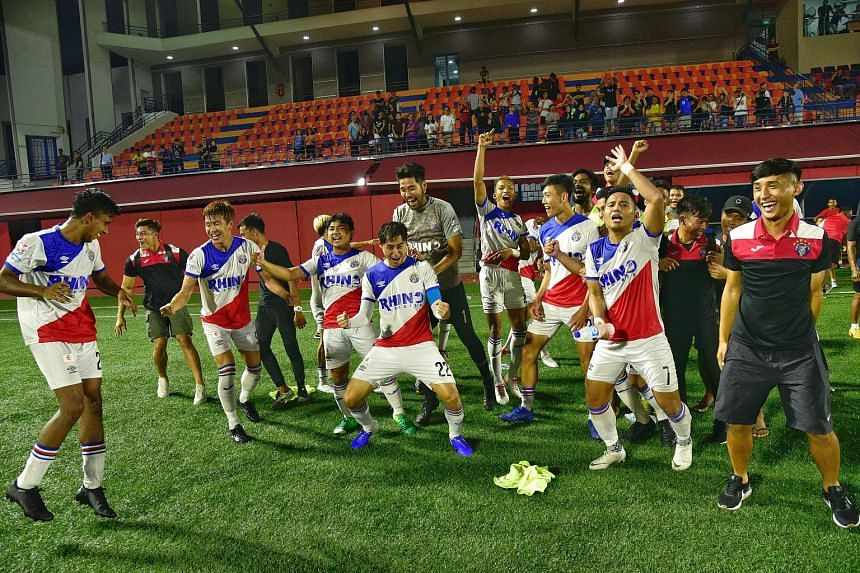 Warriors FC captain Gabriel Quak (centre) rejoicing with teammates after beating Brunei DPMM 4-2 on penalties in the Singapore Cup semi-final second leg last night. They play Tampines in Saturday's final.