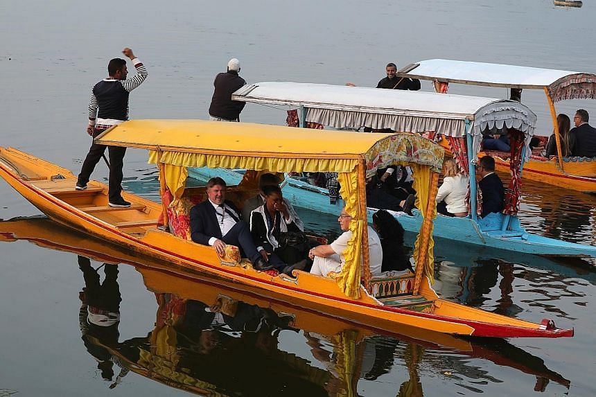 Some members of an EU delegation, comprising parliamentarians from mainly far-right parties, during a boat ride on Dal Lake in Srinagar on Tuesday. It is the first visit by an international delegation to Jammu and Kashmir since the government of Indi