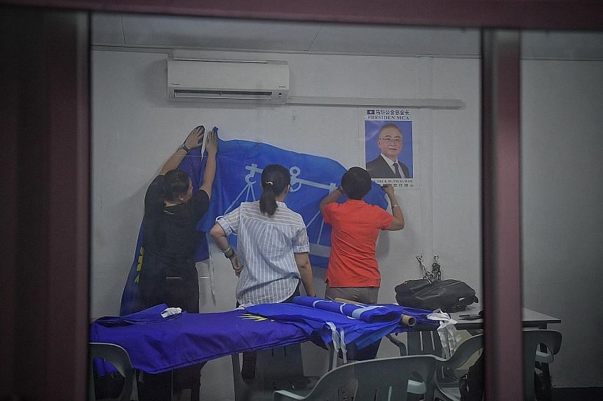 Above: MCA Tanjung Piai division chief Wee Jeck Seng lost by a narrow 524-vote margin from about 46,000 ballots cast last year. Right: Barisan Nasional officials preparing for the by-election next month.