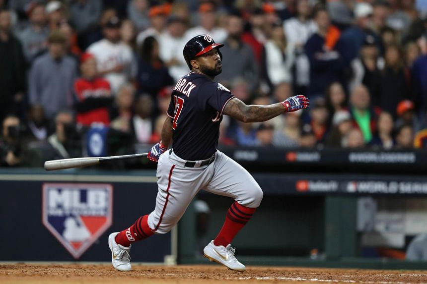 Howie Kendrick of the Washington Nationals hits a two-run home run against the Houston Astros during the seventh inning in Game Seven of the 2019 World Series at Minute Maid Park on Oct 30, 2019, in Houston, Texas.
