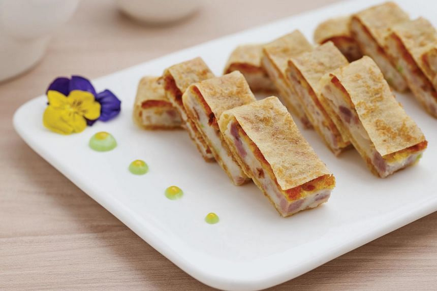 """The Fried Minced Duck Meat & Cuttlefish Paste in Egg Pancake ($14 per serving), which I'm told is a """"forgotten dish"""" that chef Ng learned in the 1970s."""