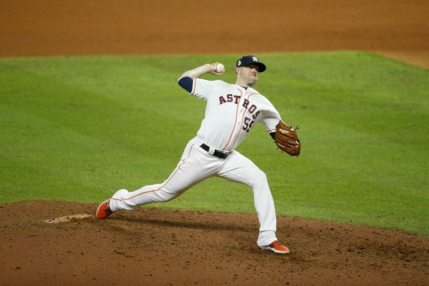 Ryan Pressly of the Houston Astros delivers the pitch against the Washington Nationals during the eighth inning in Game Six of the 2019 World Series at Minute Maid Park on Oct 29, 2019, in Houston, Texas.