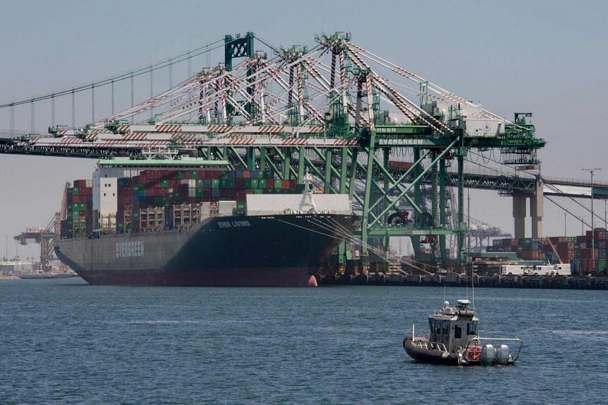 A container ship unloads its cargo from Asia, at the Long Beach port, California.