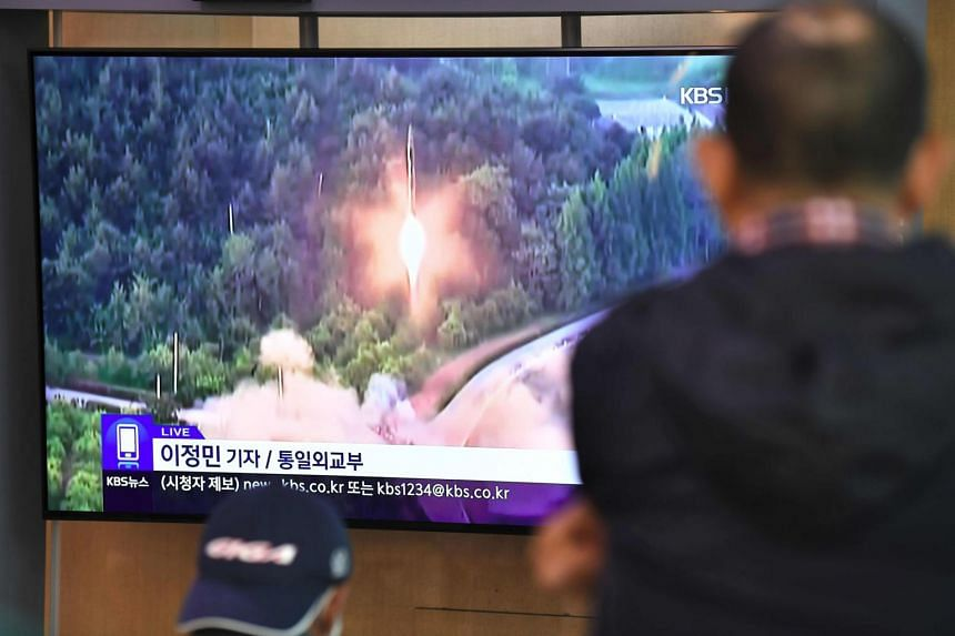 People watching a news programme showing file footage of a North Korean missile launch at a railway station in Seoul on Oct 31, 2019.