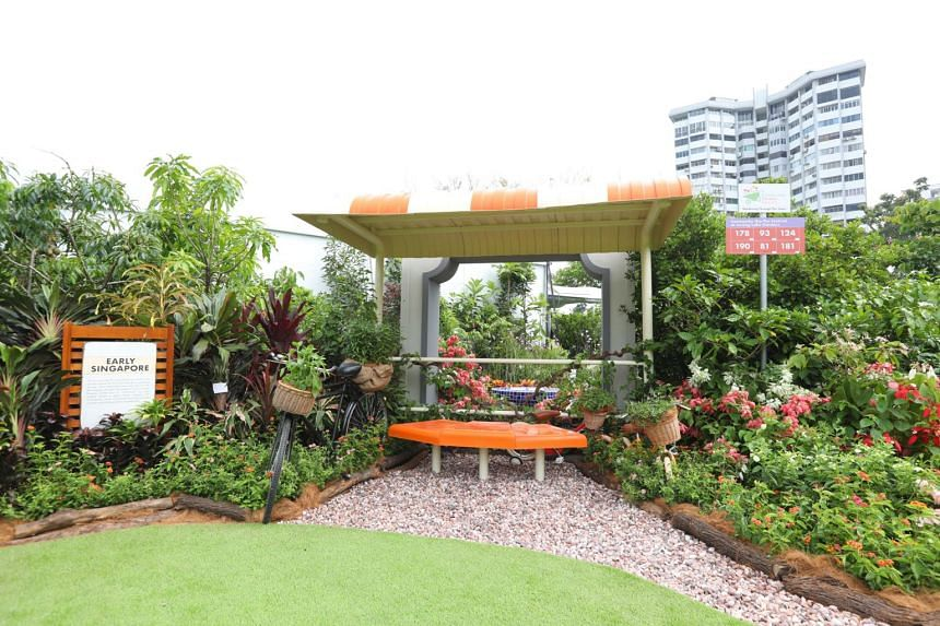 """The Early Singapore segment of the Community in Bloom Garden Display features an """"old-school"""" bus stop amid plants that were commonly grown in the past."""