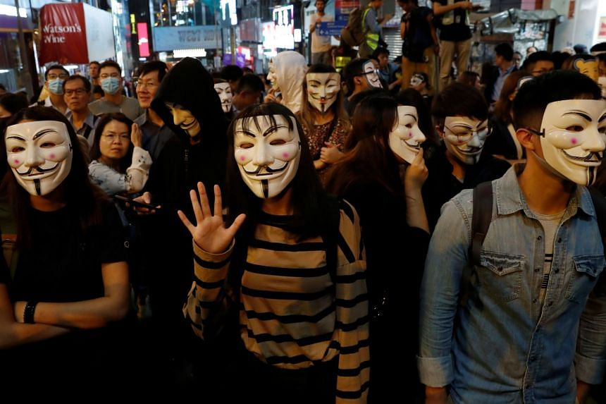 Anti-government protesters wearing costumes march during Halloween in Lan Kwai Fong,Hong Kong, on Oct 31, 2019.