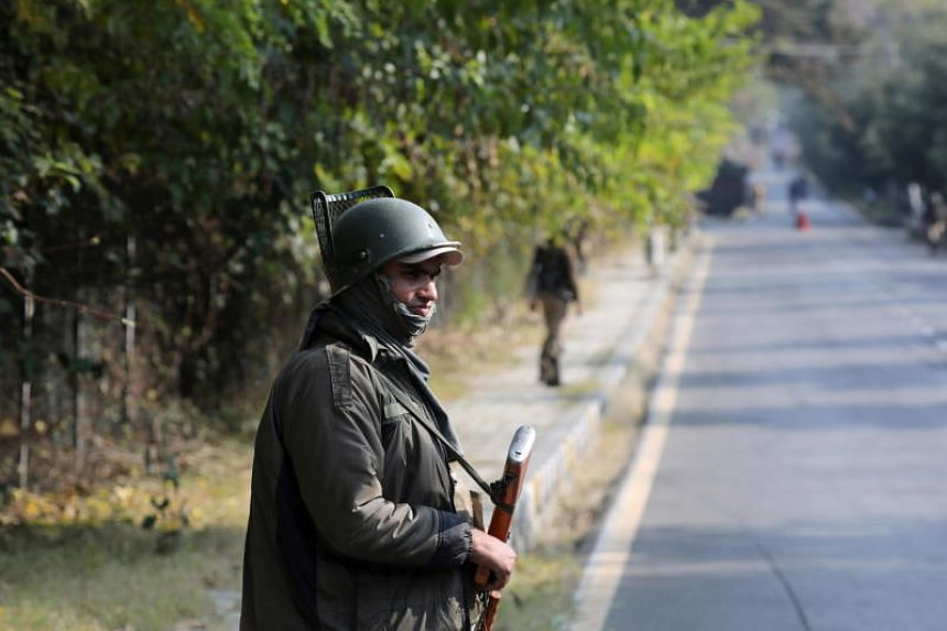 An Indian paramilitary soldier stands guard in Srinagar, India, on Oct 31, 2019.