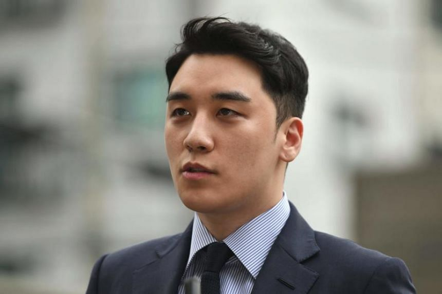Former BigBang boy band member Seungri arrives for police questioning in Seoul on Aug 28, 2019.