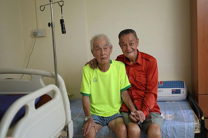 Mr Lee Cho Poon with Mr Neo Cheng Liang (far left), who moved in with him in 2017. Mr Neo, 86, suffers from dementia and is hard of hearing. More than 30 people have reached out to offer help to Mr Lee, 83, since his story was reported on Tuesday. Mr