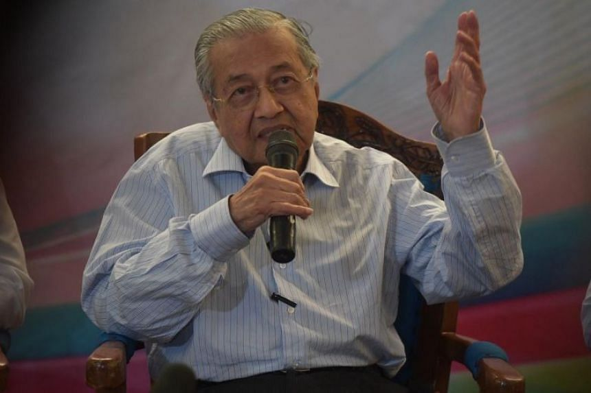 Malaysia's Prime Minister Mahathir Mohamad speaks during a press conference at the Customs, Immigration, and Quarantine Complex in Johor Baru on Oct 31, 2019.