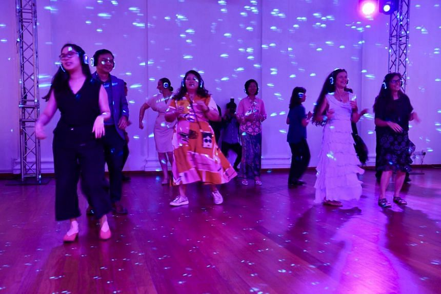 Participants dance to a Eurasian folk song at the Singapore Writers Festival opening ceremony.