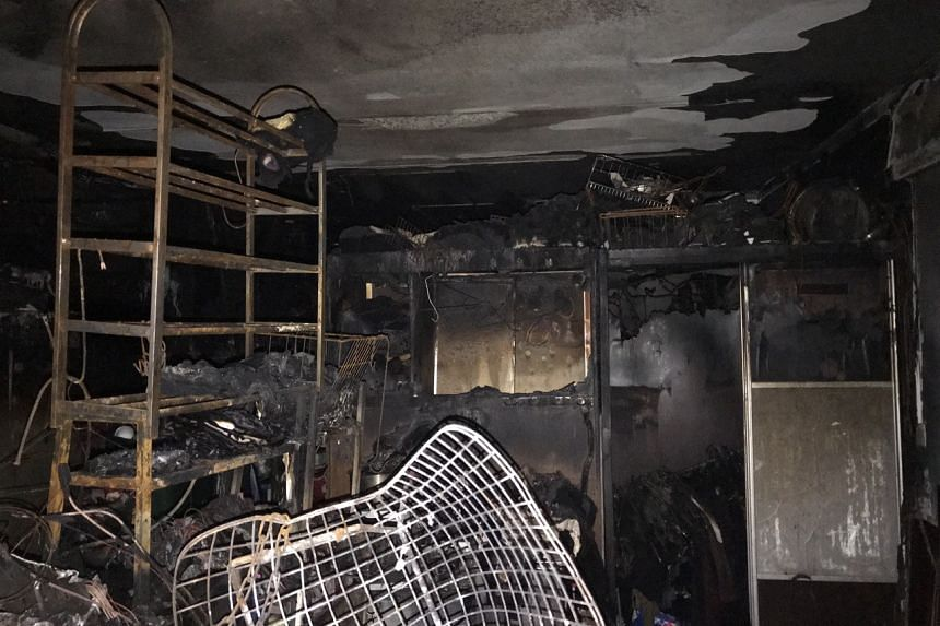 Charred remains of household items in the unit at Block 210A Bukit Batok Street 21 that caught fire early in the morning on Nov 1, 2019.