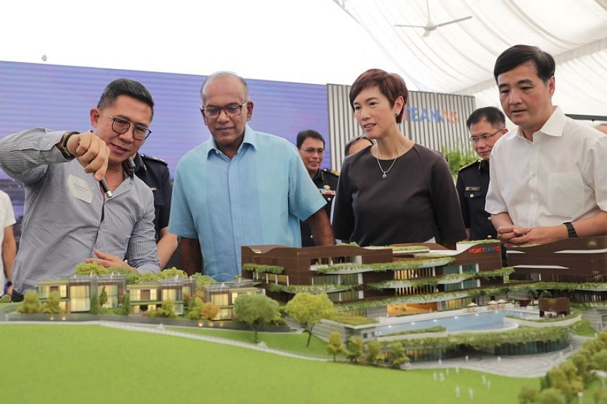 Mr Michael Vong from Surbana Jurong Consultants highlights features of the new Bedok clubhouse to Minister for Home Affairs and Law K. Shanmugam, Minister for Manpower Josephine Teo, and Senior Minister of State for Defence Heng Chee How at the facil