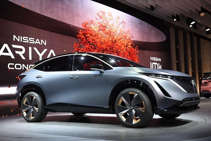 Mitusbishi quad-motor Mi-Tech electric concept buggy. Toyota Mirai hydrogen fuel cell vehicle. Nissan unveiled the electric Ariya concept at this year's Tokyo Motor Show.