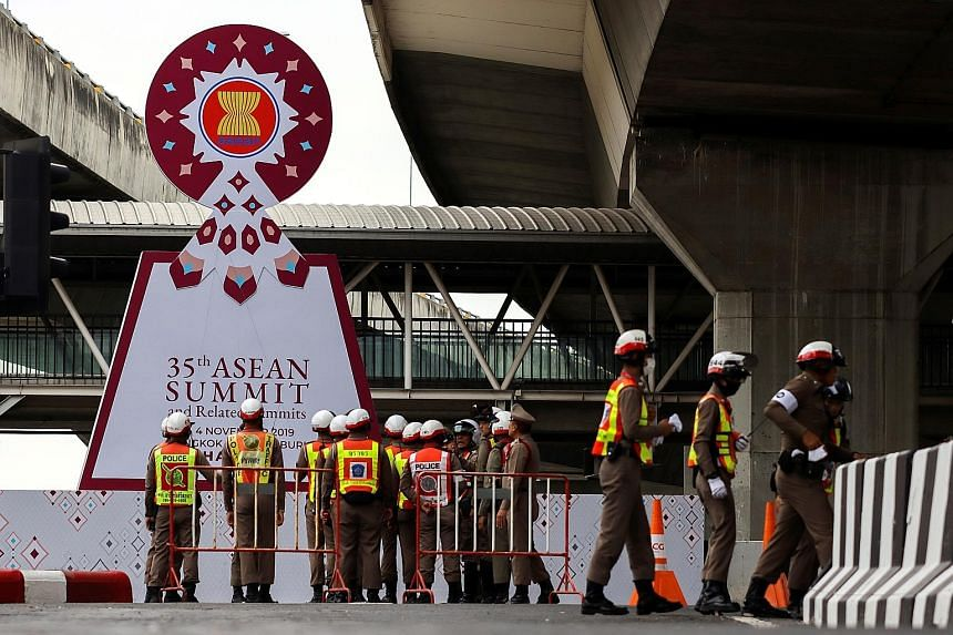 Police officers outside the summit venue in Bangkok yesterday as Thailand gears up for the Asean Summit starting this weekend. PHOTO: REUTERS