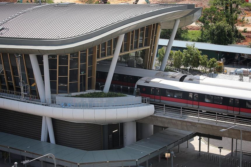 The elevated Canberra MRT station is the first where residents connect directly to the ticketing platform from an overhead bridge, said Transport Minister Khaw Boon Wan. The bridge is lined with shops and connected to Canberra Plaza at the other end.