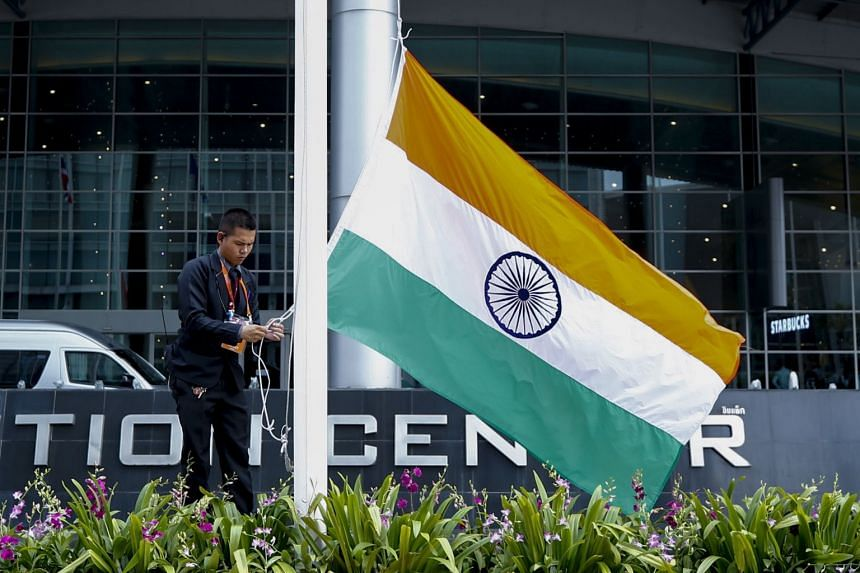 A staffer raises India's national flag outside the venue hosting the 35th Asean Summit in Nonthaburi province, Thailand, on Oct 30, 2019.