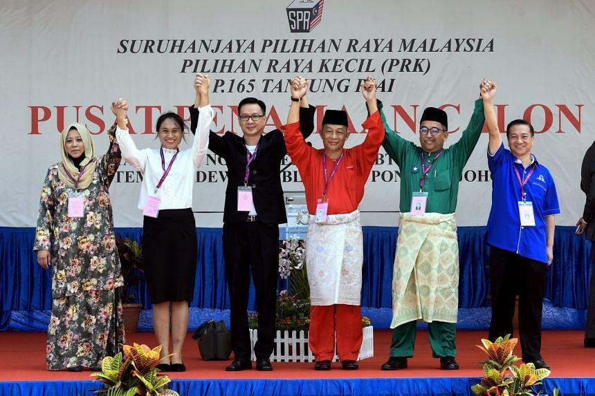 Candidates contesting in Malaysia's Tanjung Piai by-election (from left) independent Faridah Aryani Abdul Ghaffar, Gerakan's Wendy Subramaniam, independent Ang Chuan Lock, Pakatan Harapan's Karmaine Sardini, Berjasa's Badhrulhisham Abdul Aziz and Bar