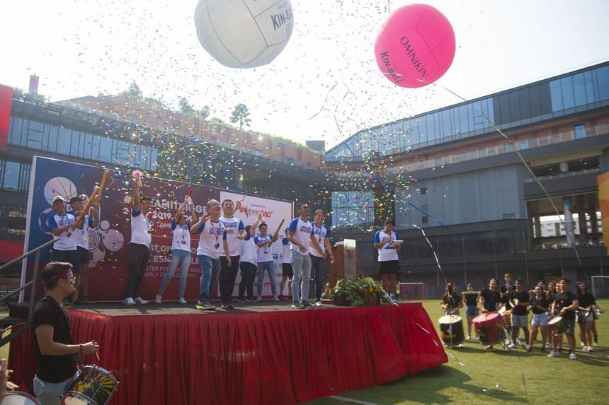 Minister for Social and Family Development Desmond Lee (on stage, centre) alongside participants of the Romp 19 sports carnival.