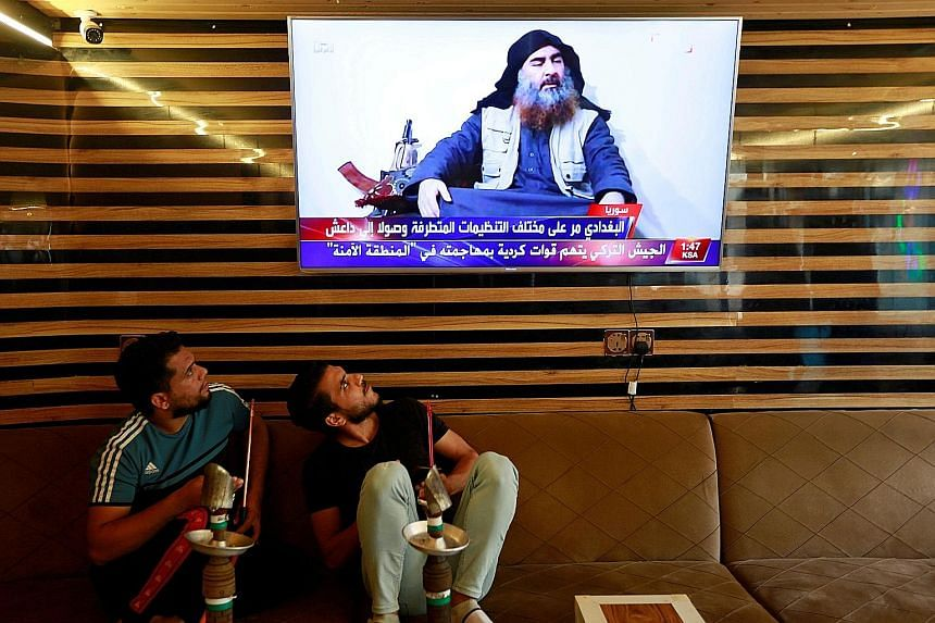 Iraqi youth watching the news about the death of ISIS leader Abu Bakr al-Baghdadi during a raid by US forces last weekend. Asia News Network writers say his death, while arguably a boost for US President Donald Trump, does not mean the terror threat