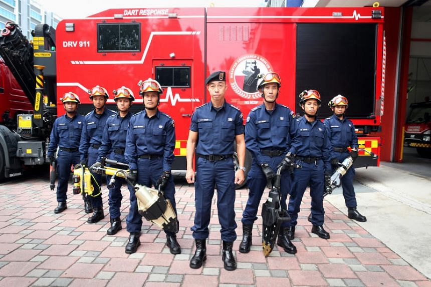 SCDF Disaster Assistance and Rescue Team (Dart) personnel who were involved in a complex three and half hour rescue operation to extricate a trapped driver of tipper truck which had rolled over on Thursday (Oct 31) afternoon along Tanah Merah Coast R