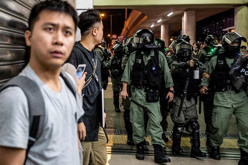 Riot police point pepper spray in Sha Tin, Hong Kong, on Nov 3, 2019.