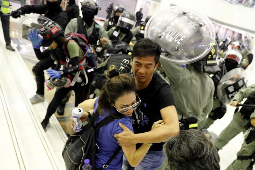 People scuffle with riot police at a shopping mall in Tai Po, Hong Kong, on Nov 3, 2019.