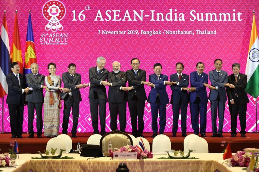 Asean leaders, including Prime Minister Lee Hsien Loong (fifth from left), with Indian Prime Minister Narendra Modi (sixth from left) and Asean Secretary-General Lim Jock Hoi (extreme right) in a group picture at the 16th Asean-India Summit on Nov 3,