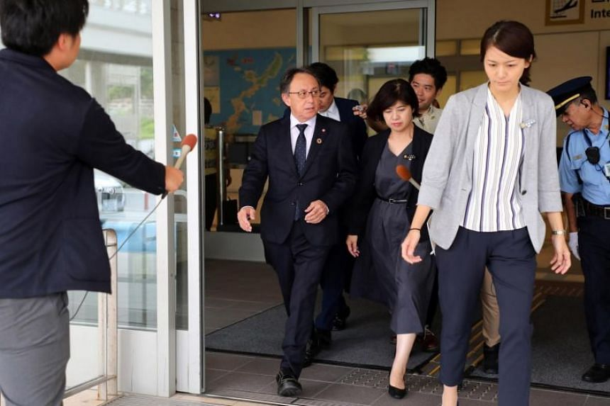 Okinawa Governor Denny Tamaki (centre) arrives at Naha airport, on Oct 31, 2019. Mr Tamaki said that any US attempt to base intermediate-range ballistic missiles in Okinawa would be firmly opposed by the local people.