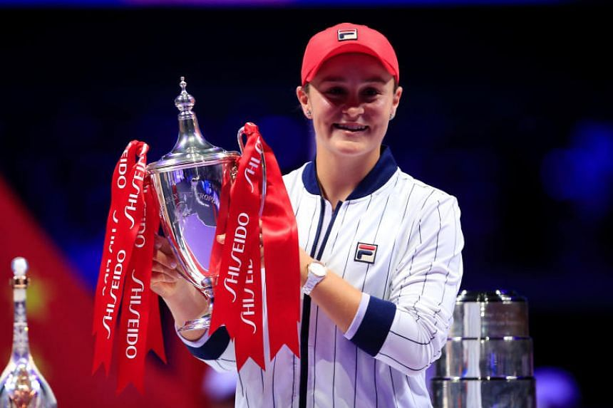 Australia's Ashleigh Barty poses with a trophy as she celebrates after winning the final against Ukraine's Elina Svitolina on Nov 3, 2019.