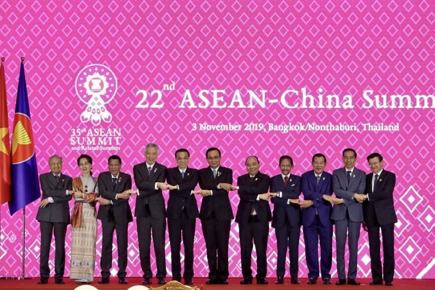 Asean leaders, alongside China's Prime Minister Li Keqiang (5th from left) pose for a picture on Nov 3, 2019.