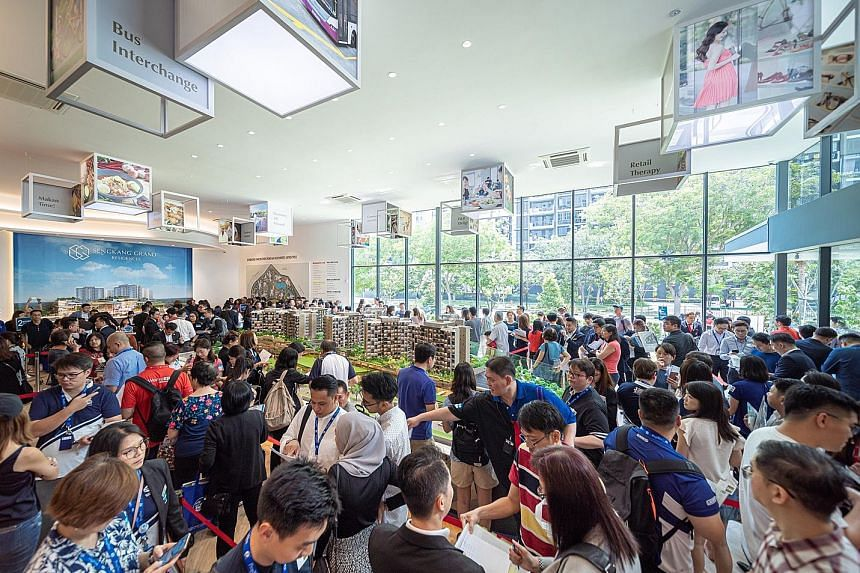Visitors at the launch of Sengkang Grand Residences over the weekend, when 280 apartments were up for sale. Besides homes, the integrated community and lifestyle hub also features a retail mall, hawker centre, community club, childcare centre, commun