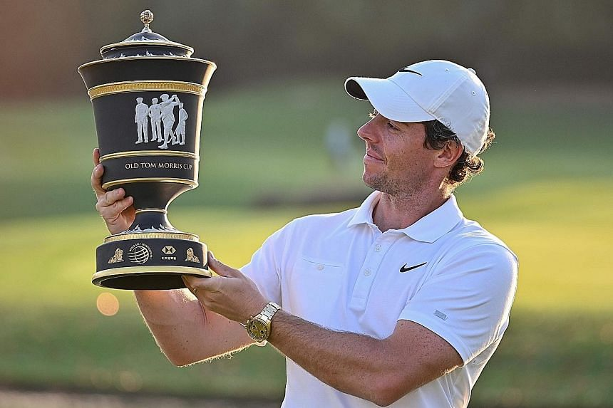 Rory McIlroy admiring his fourth trophy of the year and his 26th career title after winning the WGC-HSBC Champions in a play-off in Shanghai yesterday.