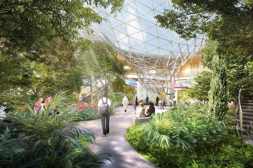 The expansion plans for Qatar's Hamad International Airport, unveiled in Doha two weeks ago, feature an indoor waterfall and massive gardens (above) that are strikingly similar to what Jewel Changi Airport (left) offers. PHOTOS: HAMAD INTERNATIONAL A