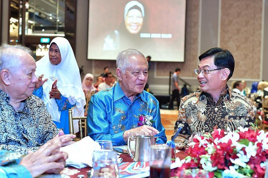 Deputy Prime Minister Heng Swee Keat with former Sang Nila Utama Secondary School (SNU) principal Muhammad Jaafar (far left) and former MP Wan Hussin Zoohri at a reunion yesterday for alumni and former teachers of SNU and Tun Seri Lanang Secondary Sc