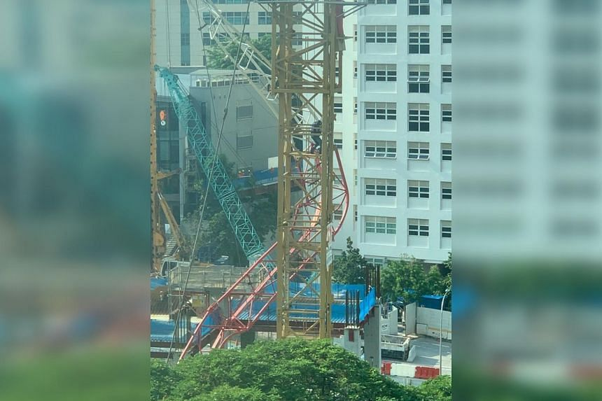 An eyewitness said she saw a crane operator stuck on top of the partially collapsed crane at the construction site, which is opposite her apartment.
