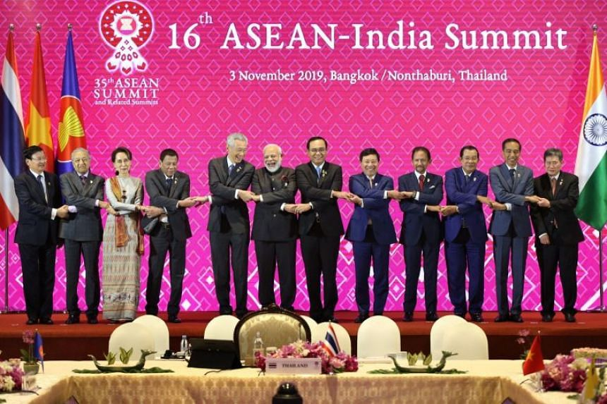 Asean leaders, including Prime Minister Lee Hsien Loong (fifth from left), with Indian Prime Minister Narendra Modi (sixth from left) and Asean Secretary-General Lim Jock Hoi (right) in a group picture at the 16th Asean-India Summit on Nov 3, 2019.