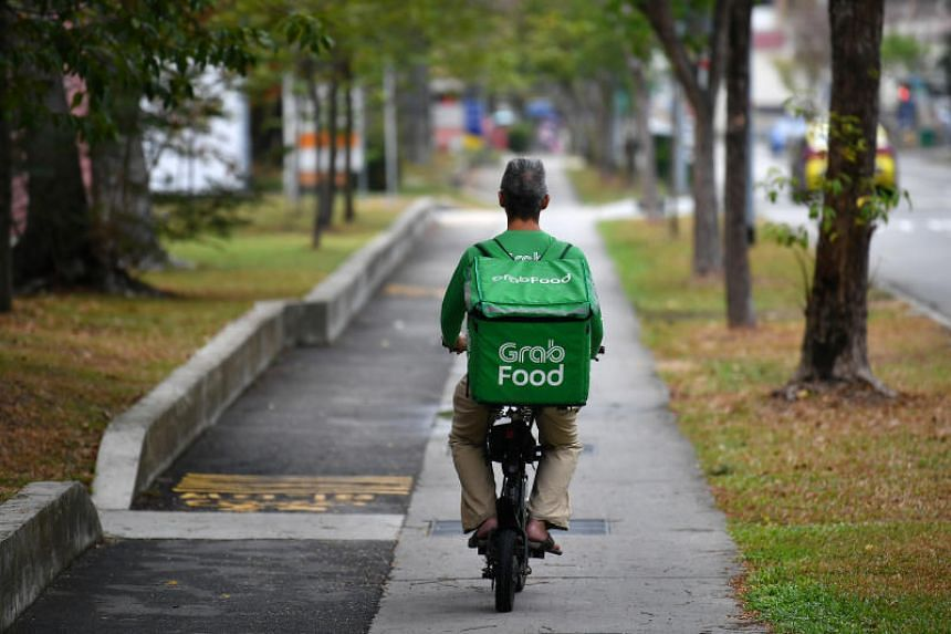 There are about 7,000 food delivery riders in Singapore who use e-scooters, the majority believed to be working for Grab.