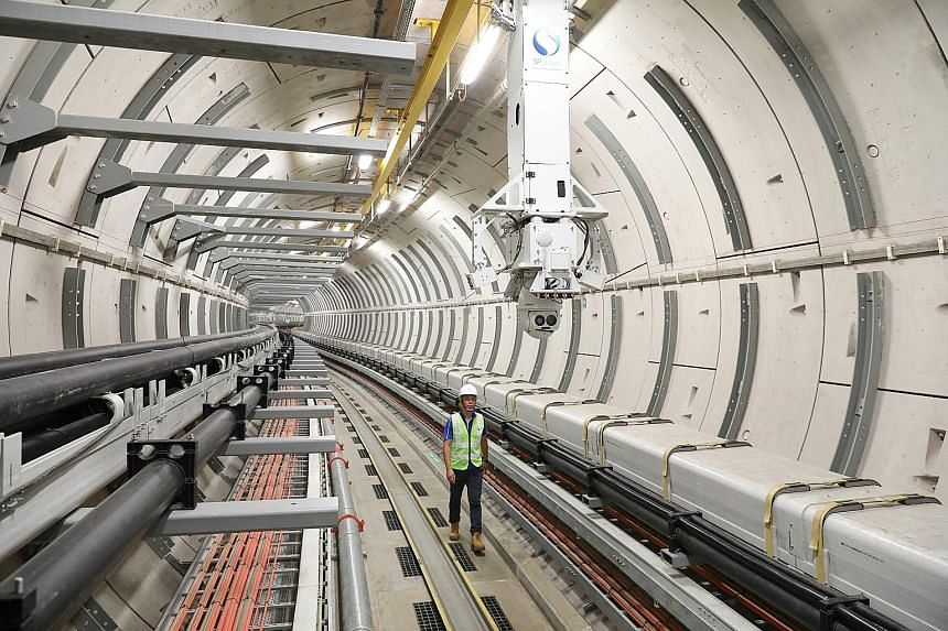 SP Group's underground transmission cable tunnel system that brings electricity to consumers. The power grid operator is looking to build transmission lines to neighbouring countries and using renewable energy credits for power trading to obtain gree