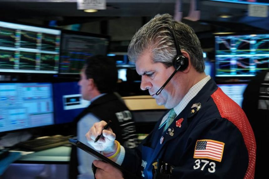 Markets Right Now: Stock indexes hover near record levels