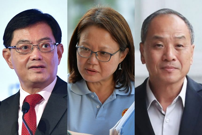 DPM Heng Swee Keat (left) tabled a parliamentary motion for WP's Sylvia Lim and Low Thia Khiang to recuse themselves from all financial matters at the AHTC.