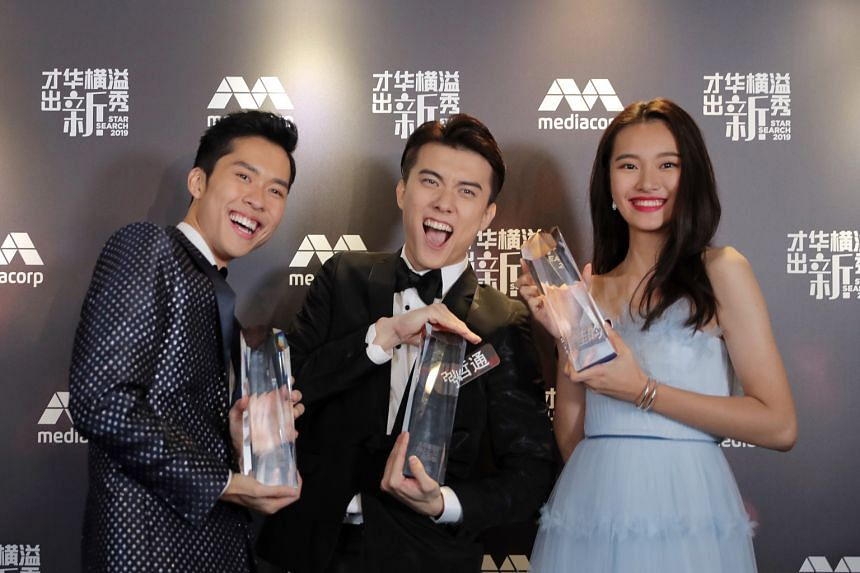 Star Search winner Teoh Ze Tong (centre), first runner-up Herman Keh (left) and second runner-up Ye Jia Yun (right) secured acting deals with Mediacorp.