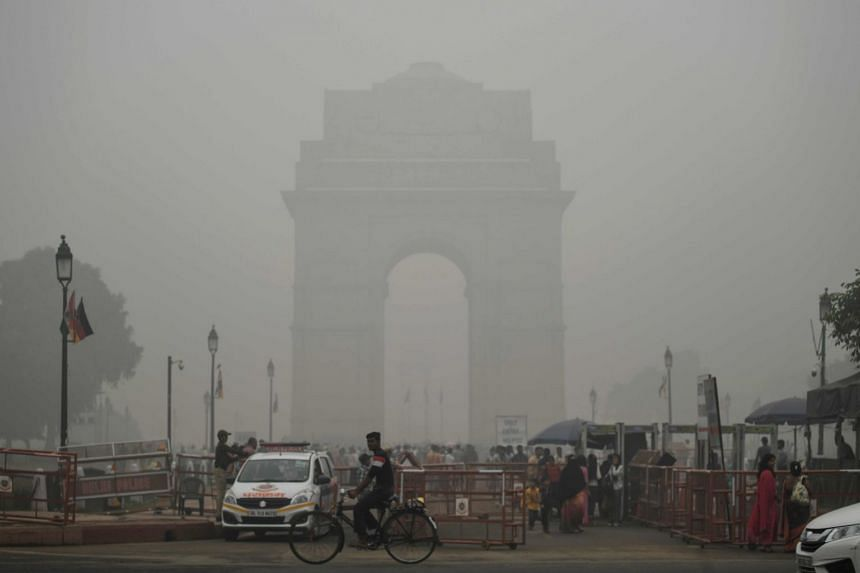 India Gate covered in heavy smog in New Delhi last Sunday. Every year, pollution worsens after Deepavali, which also coincides with farmers burning stubble, adding to an already existing cocktail of pollutants from millions of vehicles, open burning