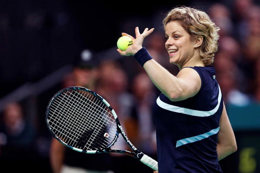 In a photo taken on Dec 12, 2012, Belgium's Kim Clijsters waves to supporters during an exhibition tennis match against Venus Williams in Antwerp. She announced plans of a surprise comeback ahead of the Australian Open in 2020.