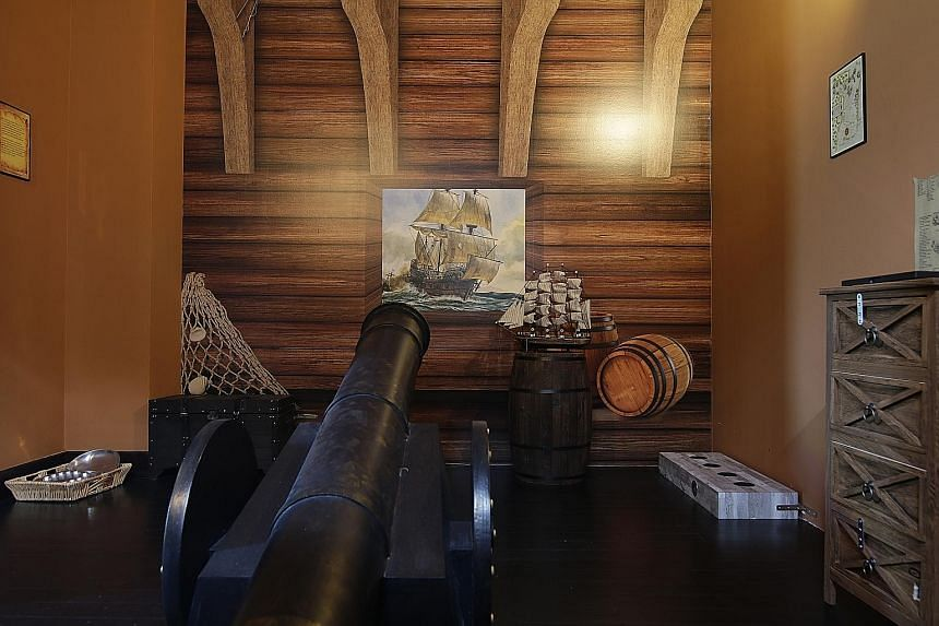This room with a cannon replica is used for one of the seven themed interactive games available at Amazing Chambers Singapura. The games are played in 22 rooms, and the rooms feature Singapore's history and Malay legends and heroes.